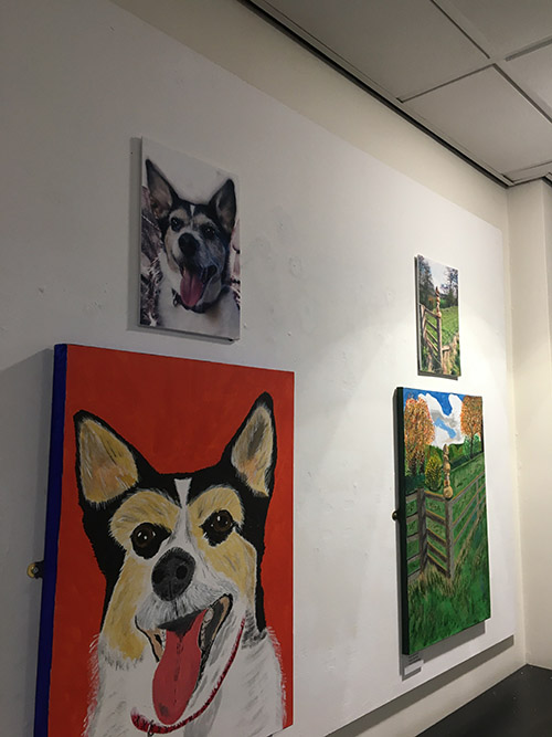 Paintings of dogs and fields