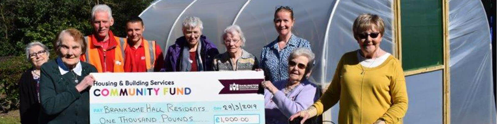 Residents receiving a community fund cheque