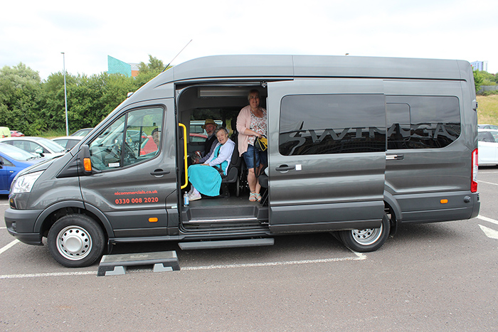 Service users on a minibus