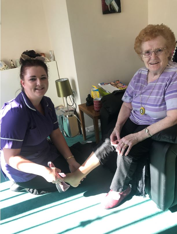 a carer assisting a resident