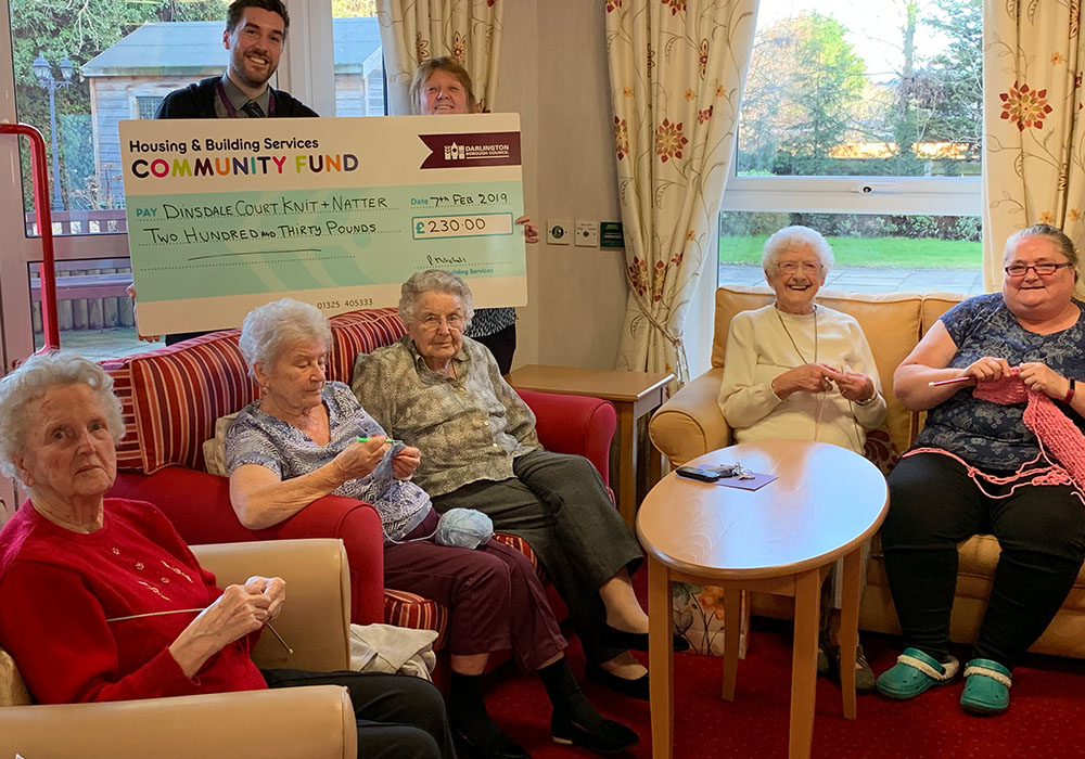 the knitting group receiving a cheque