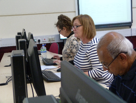 A group of ICT learners at their computers